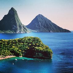 St. Lucia- Jared and I have been to this exact spot.  We actually went scuba diving right at the base of the 2 mountains you see called the grand Pitons! Beautiful!
