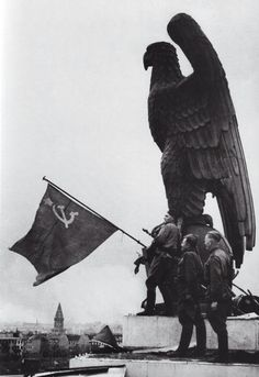 Historical moment in Berlin,1945. A staged photo by the USRR propaganda, taken two days after the fall of Reichtag.