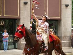 Native American Lady riding in a parade