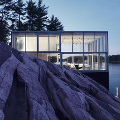 Glass pavilion on the edge of a lake in Ontario, Canada, houses a studio, apartment & boathouse for a photographer | Designed by Toronto Studio gh3. ... #Residences #House #Design #HouseDesign