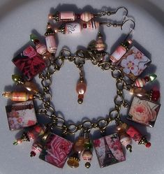 Paris Scrabble Tile and Paper Bead Bracelet. On the back it has Paris spelled out