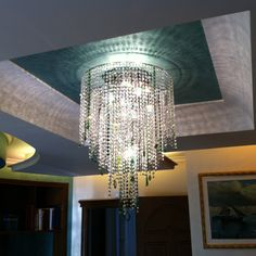 Custom #crystal ceiling lamp, decoration in clear crystals and inserts in colour crystals >> bit.ly/crystal-lighting  #crystal #crystallighting #luxurylighting #lightingpassion