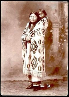 Comanche mother and child. ca. 1900