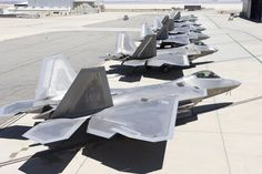 Seven F-22A Raptors sit outside the 411th Flight Test Squadron on Aug. 10, 2016. Four operational jets from three different bases were at Edwards AFB, Calif., for testing to help improve the long-term combat capability of the F-22 Raptor. Air Force photo by Christian Turner.