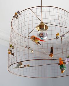 With its colorful finches and parakeets and delicate copper wire Anthropologies Songbird Chandelier is a cheery addition to the girls bedroom. Cage Light Fixture, Diy Light Fixtures, Birdcage Light, Bird Bedroom, Fantasy Bedroom, Little Girl Rooms, Inspired Homes, Decoration, Room Inspiration