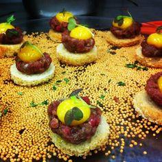 Steak Tartare on crustinis with egg yolk garnish #Decadent #Foodies #Israel