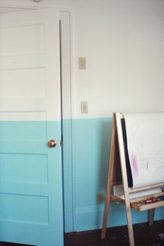 A bright + bold paint job makes this room pop! Love how the half-colored wall extends onto the door.