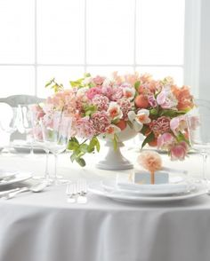 Exuberant Tabletop: fringed tulips, fruiting clementine branches, picotee-edged carnations, daffodils, sweetpeas, ranunculus