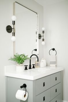 Bathroom with cool tones, black hardwdare - Studio McGee Blog