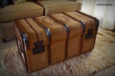 Antique trunk covered in burlap. Grain sack design on lid