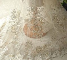 0.5 meter Width 51.18 inches ivory wedding lace fabric,Beaded embroidered lace,floral 3D lace fabric with Sequins(144-4)  ★MATERIAL  Sequins,polyester fibre,beadings  ★MEASUREMEN  Width: 130(cm)/51.18  ★QUANTITY  This listing is for 0.5 meter(19.68)   All the lace are perfect for lingerie, bra, dresses, dolls, bridal veil, altered art, couture, costume, jewelry design, pillowcase, home decor and other projects you could imagine.  If you like it, order it now. For more quantity, please feel…