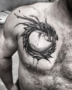 Dragon chest tattoo by ineepine.  It takes a lot of guts and determination to get your chest done. Take a look at some of the most mind blowing chest tattoos ever done. Enjoy!