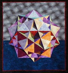 The above quilt (38″ x 42″) shows the great ditrigonal icosidodecahedron, a nonconvex uniform polyhedron consisting of twenty triangles and twelve pentagons. Although it is perfectly flat, it has a very 3D effect because the pattern includes some shadows.  From: http://momath.org/home/math-monday-08-16-10/