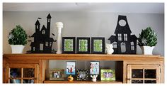 halloween decorating. Could make a whole haunted town of silhouettes on top of cabinets in kitchen. Add moon and bats