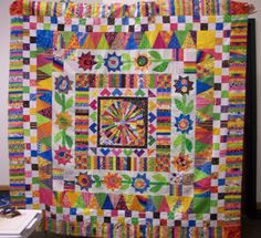 During the past year, I've worked on six different round robin quilts of varied styles, colors and fabrics in addition to sending my center . Sampler Quilts, Scrappy Quilts, Dear Jane Quilt, Lone Star Quilt, Flower Quilts, Quilt Border, Miniature Quilts, Tree Quilt, How To Finish A Quilt