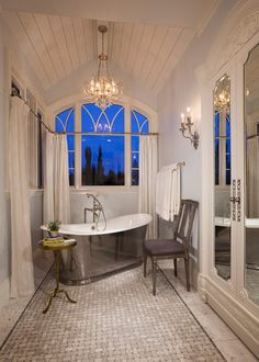 This french country nouveau style bathroom is the definition of luxury and glamour! That metallic freestanding tub is a serious statement piece.