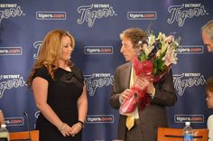 Mike presents Fielder's wife with flowers.