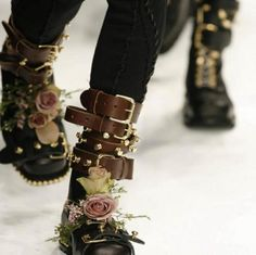 horrorproportions:  fuckyeahhardfemme:  J.W. Anderson Floral Combat Boots FW 2011  This is by FAR the most popular thing we've ever posted o...