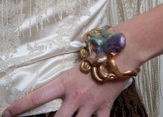 Custom Aloha Steampunk Octopus Bracelet by PurpleKoiDesigns, $25.00 http://www.etsy.com/listing/118632589/custom-aloha-steampunk-octopus-bracelet
