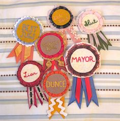 I want to do prize ribbons like this for the madlibs (or some of them) that are posted on the backs of seats in the shuttles, then after I'd like them to be displayed at the reception on a M Wall of Fame
