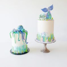 "I had two under the sea themed cakes this weekend, gotta love a matching duo! All details on the bottom of the cake are piped buttercream and on top of the mermaid cake are pastel marbled shards/coral, edible ""sand"" and more piped details."
