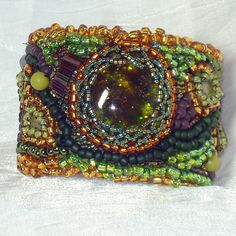 Moved to ArtQueenClaire Bead Embroidered Cuff by ArtQueenClaire, $53.00
