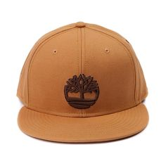 This stylish snapback features classic wheat and brown two tone color  scheme with Timberland s iconic tree 0b400d17d2b