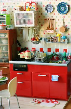 Playroom kitchen: The details are what kids will remember about home and the detail put into this play kitchen is phenomenal!