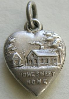 http://redrobinantiques.com/images/Antique%20Home%20Sweet%20Home%20Sterling%20Heart%205.jpg