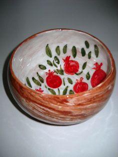 Wheel thrown pottery bowl with pomegranate design by Çiğdem Celasin