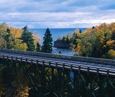 """North Shore Drive, Minnesota Lake Superior's Minnesota shoreline is a thing of glacial beauty. As you drive from Duluth toward Two Harbors, Gitche Gumee's """"shining big sea waters"""" stretch out to the right and birch and maple northwoods climb high on the left"""
