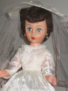 Remember BEGGING for a bride doll when I was a little girl! My little sis, Jen, got one for her birthday and chopped all her hair off and ruined her clothes...I was SO upset!