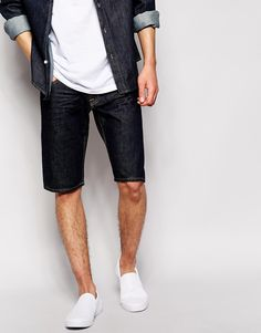 """Denim shorts by Quiksilver Stretch-denim Concealed zip fly Five pocket styling Straight fit - cut with a straight leg Machine wash 98% Cotton, 2% Elastane Our model wears a 32""""/81cm regular and is 188cm/6'2"""" tall"""
