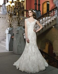 Just imagine yourself walking through your vineyard wedding in this beaded lace trumpet wedding dress. #swoon