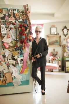 Linda Rodin in her apt. I love her collage wall -- I want one! Also would love to look that great at 63.