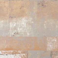 Henge is a faux finish metal textured wallpaper. It has a rustic corroded stone look for an unmatched texture and depth. Use it in your office or living room.