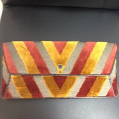 🎉SALE🎉Marc Jacobs clutch.  NWOT Marc Jacobs multicolor clutch.  New without tags.  Never worn.  Great colors and piece to wear for the Fall and winter season! Bags Clutches & Wristlets