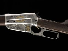 Winchester Model 1895.  Browning's final lever action design is most closely identified with Theodore Roosevelt, its most prominent and enthusiastic fan.  The robust housing in front of the lever holds a box magazine, which was necessary to hold powerful military and big game caliber ammunition ranging from .30-40 Krag, to .30-06, to .405 Winchester.