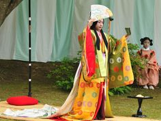 A woman playing the empress (or some other high ranking station) at a Kyokusui No En (a heian era poetry party)