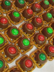 Rolo M Pretzels - square pretzels topped with a Rolo, baked in the oven at 300 for 5 minutes.  Top with M and let set.