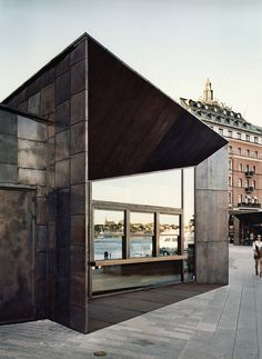 Brass squares give patchwork facade to Stockholm ferry terminal.