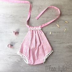 This gorgeous handmade baby Romper is perfect for any special occasion. Made from 100% designer cottons. Playsuit can either be tied at the neck or tied at the back of the playsuit near the elastic.     ♡ Available in sizes Newborn. If unsure of sizes please feel free to get in contact with us and we will help you out.