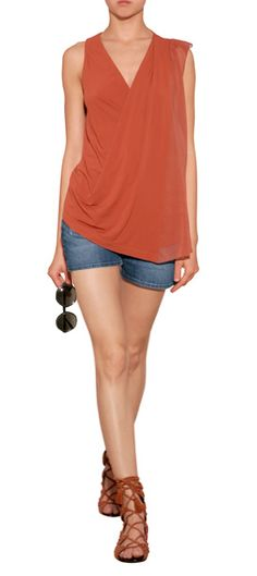 A rich terracotta hue and asymmetric drape lends this sheer detailed tank from Donna Karan a high-style finish #Stylebop