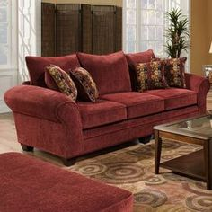 """Chenille-upholstered burgundy sofa with a hardwood frame.     Product: Sofa   Construction Material: Hardwood frame and chenille upholstery   Color: Burgundy   Features:  Includes four throw pillows  Removable seat cushions  High resilience seat foam for superior durability and comfort  Made in the USA   Dimensions: 44"""" H x 100"""" W x 45"""" D"""