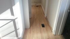 new hardwood in the hallway leading into the bathroom