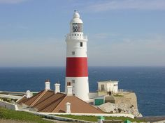 Europa Point Lighthouse (Trinity Lighthouse at Europa Point), Gibraltar Rock Of Gibraltar, Trinity House, Lighthouse Art, Lighthouse Pictures, Point Light, White Lanterns, Beacon Of Light, Peaceful Places, Fortification