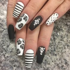 Be a black and white beauty with these matte black and white designs. You have the classic and simple black and white stripes and polka dots as well as a glamorous black and diamond nail art plus a vintage feel of black roses.