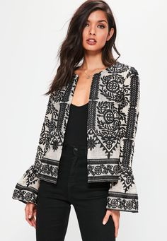 Make a serious style statement without breaking the bank in this standout embroidered jacket - featuring a mesh overlay, black contrast embroidery and wide sleeves.