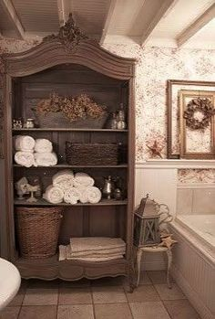 I like this Idea for the bathroom  an open cupboard with beadboard for towels an decor