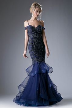 Floor Length Mermaid Prom and Evening Dress with Intricate Beadwork Embellished Bodice has Sweetheart Neckline featuring Spaghetti Straps and Low Back with Zipper Closure, Layered Long Skirt with Slight Train Completes the Style with Elegance.